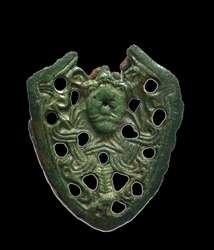Wczesnośredniowieczny trzewik (dolne okucie pochwy miecza) z wizerunkiem Odyna.